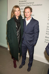 GUY PELLY and his wife ELIZABETH at the opening of the exhibition Champagne Life in celebration of 30 years of The Saatchi Gallery, held on 12th January 2016 at The Saatchi Gallery, Duke Of York's HQ, King's Rd, London.