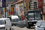 Heavy traffic is causing air pollution as people are driving vehicles on a busy street in Penang, Malaysia.