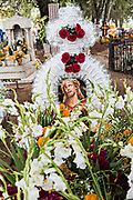 An elaborate wreath and floral decorations on a gravesite during the Day of the Dead festival October 31, 2017 in Tzintzuntzan, Michoacan, Mexico. During the festival, which dates back hundreds of years to Aztec rituals, family members decorate the tombs of loved ones and celebrate them with gifts, food and altars.