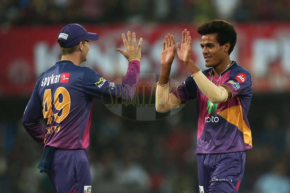 Rising Pune Supergiant captain Steven Smith congratulates Rahul Chahar of Rising Pune Supergiant for getting Hashim Amla of Kings XI Punjab wicket during match 4 of the Vivo 2017 Indian Premier League between the Kings XI Punjab and the Rising Pune Supergiant held at the Holkar Cricket Stadium in Indore, India on the 8th April 2017<br /> <br /> Photo by Shaun Roy - IPL - Sportzpics