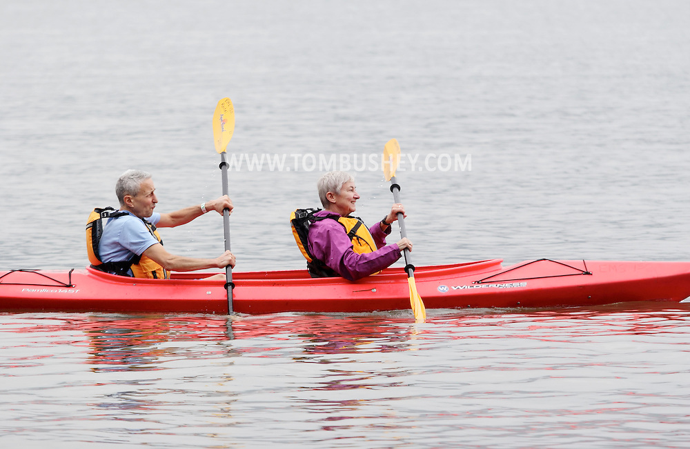 New Windsor, New York - An elderly couple paddle their kayak take to the Hudson River at the Paddlefest event sponsored by the Mid-Hudson Chapter of the Adirondack Mountain Club at Kowawese Unique Area at Plum Point on June 13, 2010.
