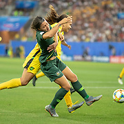 GRENOBLE, FRANCE June 18.  Sam Kerr #20 of Australia is challenged in the penalty area by Toriana Patterson #19 of Jamaica during the Jamaica V Australia, Group C match at the FIFA Women's World Cup at Stade des Alpes on June 18th 2019 in Grenoble, France. (Photo by Tim Clayton/Corbis via Getty Images)