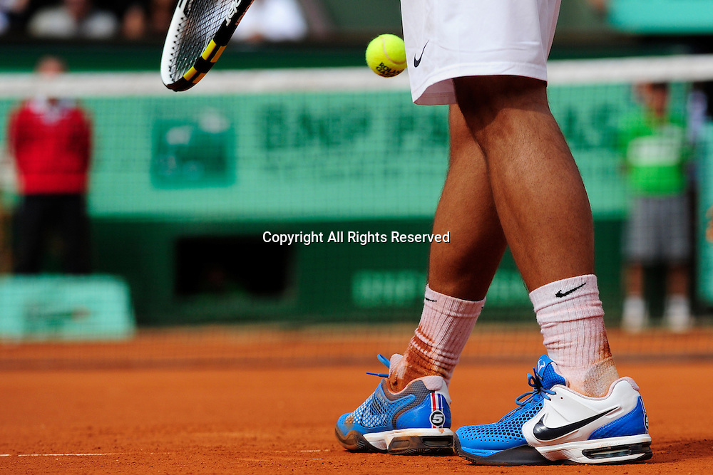 24.05.2011 French Open Tennis from Roland Garros Paris. View of Rafael Nadal's shoes as he prepares to serve in his match against John Isner of the USA on day three of the French Open tennis championships.