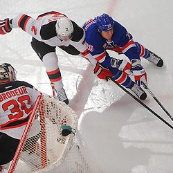 May 23, 2012: New York Rangers left wing Ruslan Fedotenko (26) controls the puck away from New Jersey Devils defenseman Marek Zidlicky (2) behind goalie Martin Brodeur's (30) net during first period action in game 5 of the NHL Eastern Conference Finals between the New Jersey Devils and New York Rangers at Madison Square Garden in New York, N.Y.