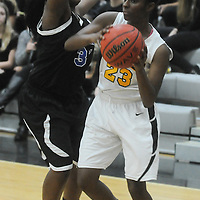 Trask's Saniyyah Mccallister guards Topsail's Brandy Williams Friday December 5, 2014 at Topsail High School in Hampstead, N.C. (Jason A. Frizzelle)