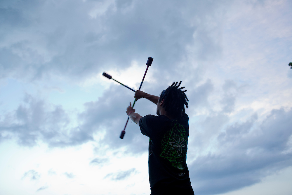 Jeremy Camacho of Chicago practices juggling at Camp Euforia, north of Lone Tree, on Thursday, July 16, 2015. Camacho belongs to a performance group called the Chicago Fire Technicians, who will be performing throughout the three-day music festival.