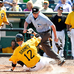 March 22, 2012; Bradenton, FL, USA; Pittsburgh Pirates shortstop Clint Barmes (12) scores on a double by Nate McClouth during the bottom of the fifth inning of a spring training game at McKechnie Field. Mandatory Credit: Derick E. Hingle-US PRESSWIRE