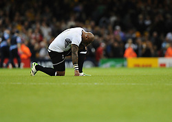 Fiji players reflect on a hard game  - Mandatory byline: Joe Meredith/JMP - 07966386802 - 23/09/2015 - Rugby Union, World Cup - Millenium Stadium -Cardiff,Wales - Australia v Fiji - Rugby World Cup 2015 - Pool A
