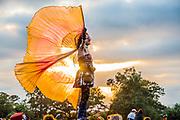 Waitng for the sunset at the stone circle, the Sacred Place - The 2019 Glastonbury Festival, Worthy Farm. Glastonbury, 26 June 2019