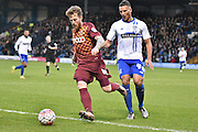 Bradford City Forward, Billy Clarke steers the ball away from an advancing Bury Defender, Reece Brown during the The FA Cup third round match between Bury and Bradford City at Gigg Lane, Bury, England on 9 January 2016. Photo by Mark Pollitt.