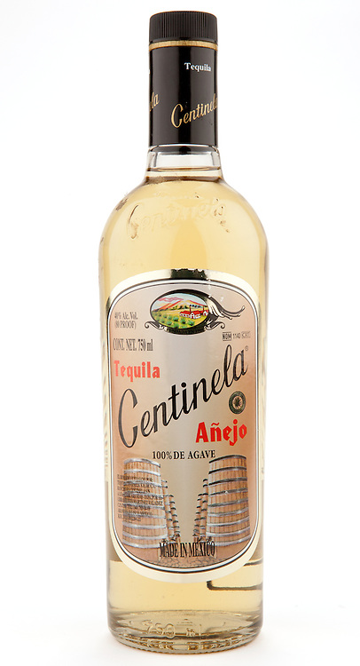Centinela Añejo (round bottle) -- Image originally appeared in the Tequila Matchmaker: http://tequilamatchmaker.com