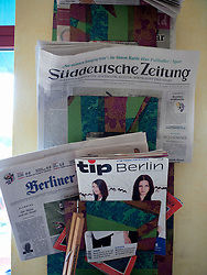Detail of magazine rack in bohemian cafe Tasso on Karl Marx Allee in former East Berlin Germany