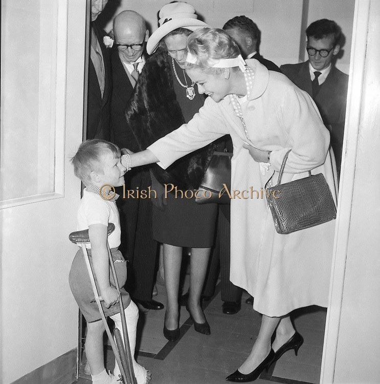 One of most popular visitors to Ireland was Her Serene Highness, Princess Grace of Monaco, formerly Grace Kelly. Here she chats with a  young patient in Our Lady's Hospital for Sick Children, Crumlin..12.06.1961