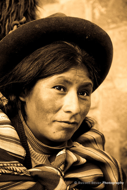 A quechua woman poses for a photo in Cusco, Peru