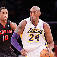 08 December 2013: Los Angeles Lakers shooting guard Kobe Bryant (24) drives past Toronto Raptors shooting guard DeMar DeRozan (10) during the third quarter of the game between the Los Angeles Lakers and the Toronto Raptors at the Staples Center, Los Angeles, California, USA.