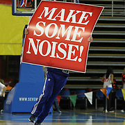 "A member of the Philadelphia 76ers flight squad performs with signs that reads ""Make Some Noise"" during a time out of a NBA D-league regular season basketball game between Delaware 87ers (76ers) and the Erie BayHawks (Knicks) Friday, Jan. 3, 2014 at The Bob Carpenter Sports Convocation Center, Newark, DE"