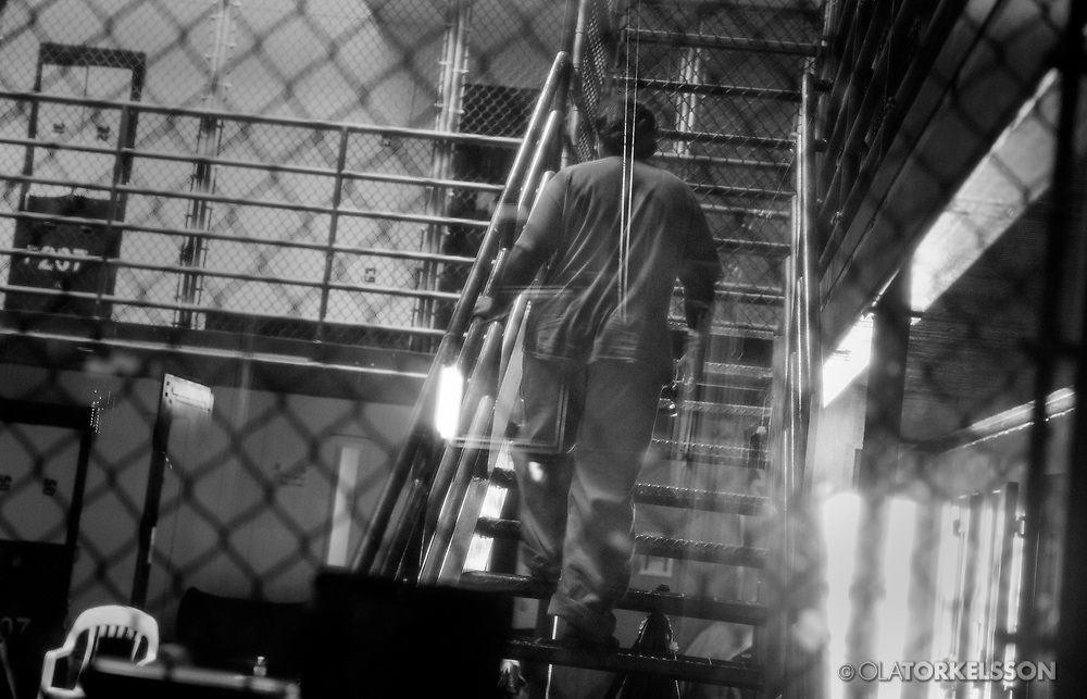 A prisoner inside the prison at Guantanamo, Cuba, Jan 28 2017.<br /> You are not allowed to publish pictures of the prisoners showing their complete faces. When you work as a journalist at the Guantanamo you work under military censorship and all your material is checked every day and approved for publication. <br /> The prison camp on the Guant&aacute;namo naval base was the creation of President George W. Bush. The prison camp was considered an important part of the US war on terrorism. Over the years, 779 people have been brought to the camp. 41 people are still detained. Of them, 26 people count as &quot;forever prisoners&rdquo;, indefinite detainees under the Law of War. Two prisoners have been in the camp since it was opened in January 2002. The last prisoner taken to the camp came in March 2008. The so-called war on Terror and the Guantanamo prison camp have been heavily criticized for violation of human rights regarding torture and habeas corpus.<br /> It is unclear what US President Donald Trump wants to do with the camp, but during the election campaign he said that he would fill Guant&aacute;namo Bay with &quot;bad dudes&quot;. Photo by Ola Torkelsson<br /> Copyright Ola Torkelsson &copy;