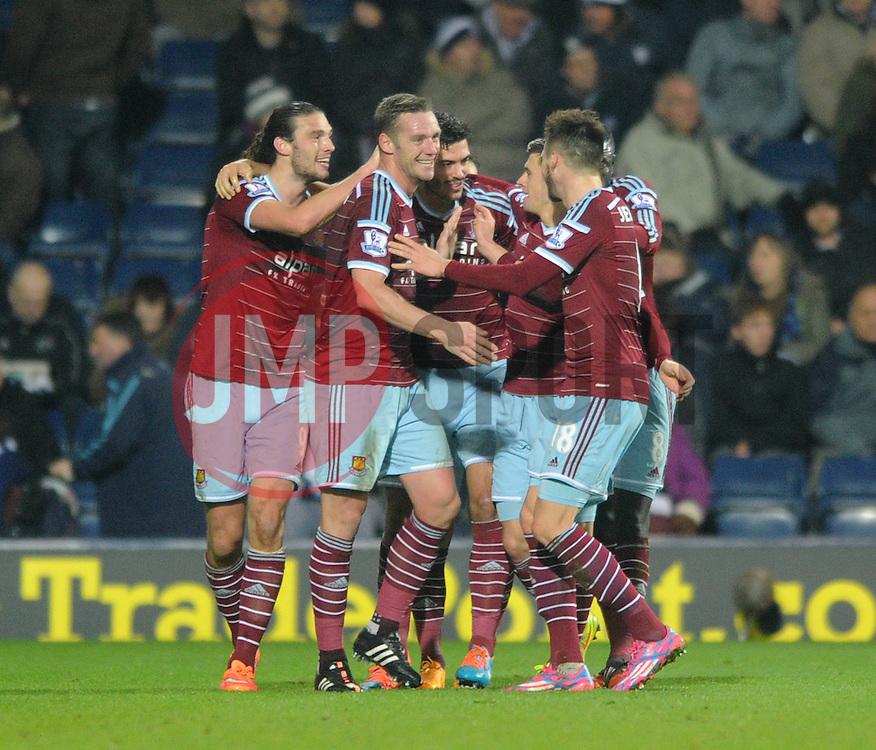 West Ham's James Tomkins celebrates with his team mates after scoring. - Photo mandatory by-line: Dougie Allward/JMP - Mobile: 07966 386802 - 02/12/2014 - SPORT - Football - West Bromwich - The Hawthorns - West Bromwich Albion v West Ham United - Barclays Premier League