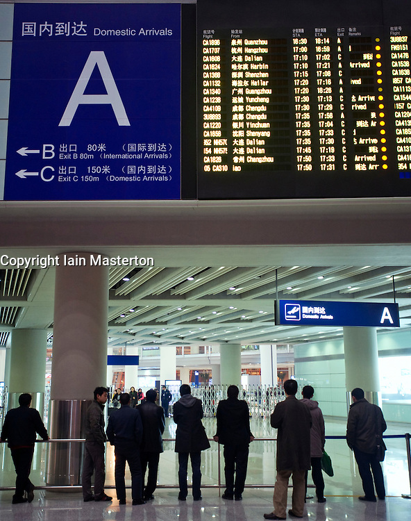 Domestic Arrivals flight information electronic display board at new Beijing Airport Terminal 3 China 2009
