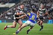 Hull FC back row forward Jordan Lane (26) is about to be tackled by Leeds Rhinos centre Joel Moon (6) during the Betfred Super League match between Hull FC and Leeds Rhinos at Kingston Communications Stadium, Hull, United Kingdom on 19 April 2018. Picture by Mick Atkins.