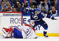 Tampa Bay Lightning's Victor Hedman (R) celebrates his goal past Montreal Canadiens goalie Carey Price during the third period of an NHL hockey game in Tampa, Florida February 12, 2013.  REUTERS/Mike Carlson (UNITED STATES)