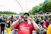 """Tyler CZ (last names abbreviated on request), shouts, """"It's not working!"""" towards Pokémon GO Fest staff on stage in response to the Pokémon GO game server not allowing several fest participants to play at Grant Park on July 22, 2017."""