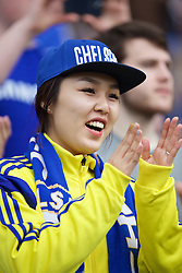LONDON, ENGLAND - Sunday, May 3, 2015: A female Asian Chelsea supporter during the Premier League match against Crystal Palace at Stamford Bridge. (Pic by David Rawcliffe/Propaganda)