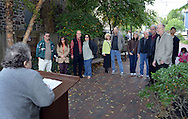 Pastor Ginny Miles (left) performs a mass commitment ceremony to married couples and those in committed relationships Saturday October 17, 2015 at Ferry Street Park in New Hope, Pennsylvania.  (Photo by William Thomas Cain)
