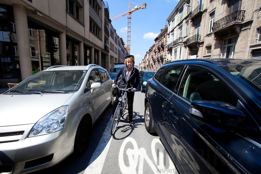 BRUSSELS - BELGIUM - 29 MAY 2010 -- Connie Hedegaard, EU-Commissioner for Climate, cucling at Rue Stevin near the European Commission HQ, Berlaymont. PHOTO: ERIK LUNTANG / INSPIRIT Photo.