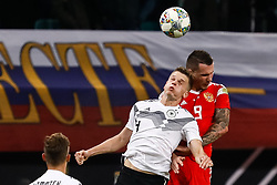 November 16, 2018 - Leipzig, Germany - Matthias Ginter (C) of Germany and Anton Zabolotny of Russia vie for a header during the international friendly match between Germany and Russia on November 15, 2018 at Red Bull Arena in Leipzig, Germany. (Credit Image: © Mike Kireev/NurPhoto via ZUMA Press)