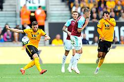 Johann Gudmundsson of Burnley blocks a shot from Matt Doherty of Wolverhampton Wanderers- Mandatory by-line: Nizaam Jones/JMP- 16/09/2018 - FOOTBALL - Molineux - Wolverhampton, England - Wolverhampton Wanderers v Burnley - Premier League