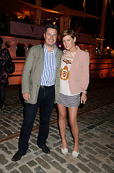 Johnnie Walker Gold Label Reserve Finale Celebration Party aboard the John Walker & Sons Voyager moored at the Prince of Wales Docks, Leith, Edinburgh, Scotland on 14th August 2013.<br /> Picture shows:-Rodolphe Combes and Gemma Gillespie.