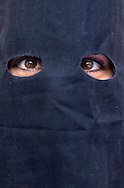 Eyes of a peniente.Holy Week procession.`La Sed´.Holy Wednesday. Seville. Spain