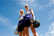 Two you women pose for a portrait in Camboodia while biking for the mental charity