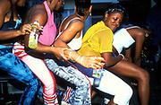 Ragga girls forming a human train-like dance, Notting Hill carnival, London, UK 2000's