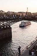 France. Paris. large group of people gathering for a piknik with friends on the pont des arts on the Seine river     / pique nique entre amis sur  la passerelle des arts sur la Seine