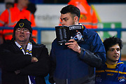 Leeds United fans read there match day programme before kick-off during the EFL Sky Bet Championship match between Leeds United and West Bromwich Albion at Elland Road, Leeds, England on 1 March 2019.