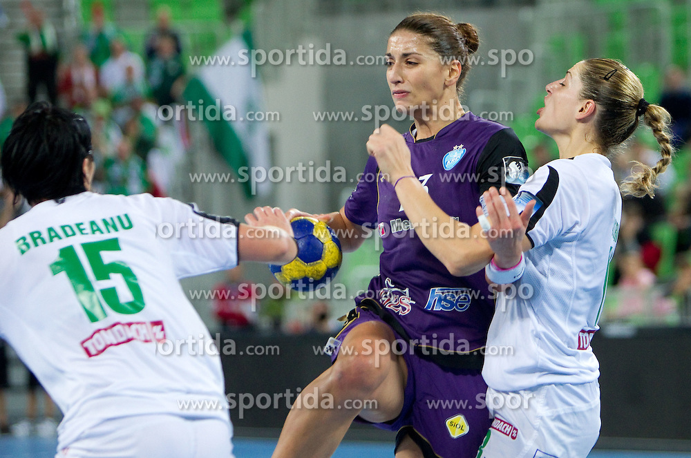 Andrea Penezic of Krim between Aurelia Bradeanu of Gyori and Eduarda Amorim of Gyori  during handball match between RK Krim Mercator (SLO) and Gyori Audi Eto KC (HUN) in 3rd Round of Women's Champions league, on October 23, 2010 at SRC Stozice, Ljubljana, Slovenia. Gyori defeated Krim 34 - 30. (Photo By Vid Ponikvar / Sportida.com)