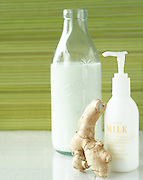 Ginger Milk lotion with green background