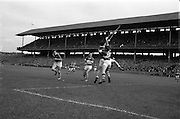 06/09/1964<br /> 09/06/1964<br /> 6 September 1964<br /> All-Ireland Minor Final: Cork v Laois at Croke Park, Dublin.<br /> Cork forward, A. Flynn (center) and Laois back, M.  McDonnell (3) jump for this high ball near the Laois goal. On the left is L. Purcell (Laois).