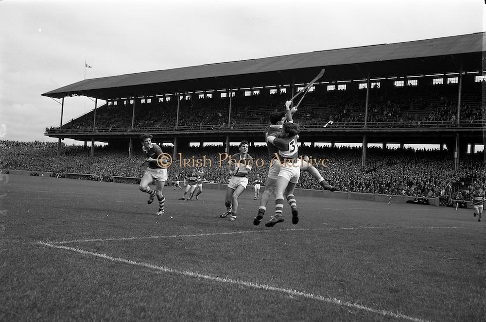 06/09/1964<br /> 09/06/1964<br /> 6 September 1964<br /> All-Ireland Minor Final: Cork v Laois at Croke Park, Dublin.<br /> Cork forward, A. Flynn (center) and Laois back, M.  McDonnell (3) jump for this high ball near the Laois goal. On the left is L. Purcell (Laois).