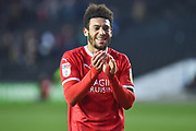 Swindon Town forward Keshi Anderson (10) Smiles as he applauds the Swindon supporters during the EFL Sky Bet League 2 match between Milton Keynes Dons and Swindon Town at stadium:mk, Milton Keynes, England on 9 February 2019.