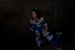 A pregnant addict in an abandoned building, Phnom Penh, Cambodia.<br />