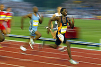 Photograph: Scott Heavey.<br />IAAf Super Grand Prix. Norwich Union London Athletics meeting from Crystal Palace. 08/08/2003.<br />Malcom Christie sprints ahead to win the 200m.