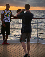 Happy Students out on Deck for Sunset after the Seas Calmed. Image taken with a Nikon D800 camera and 70-300 mm VR lens.