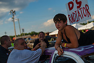 """Jacob Hinkle, 13, rests on top of his car before the demolition derby at the Summitt County Fairgrounds, Thursday, July 26, 2016 in Tallmadge, Ohio. This will be Jacob's first race, and he """" ... doesn't feel nervous at all."""""""