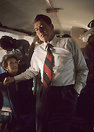 With Nancy Reagan intently watching, Candidate Ronald Reagan talks to press on a plane to Florida in 1976..Photograph by Dennis Brack bb 34