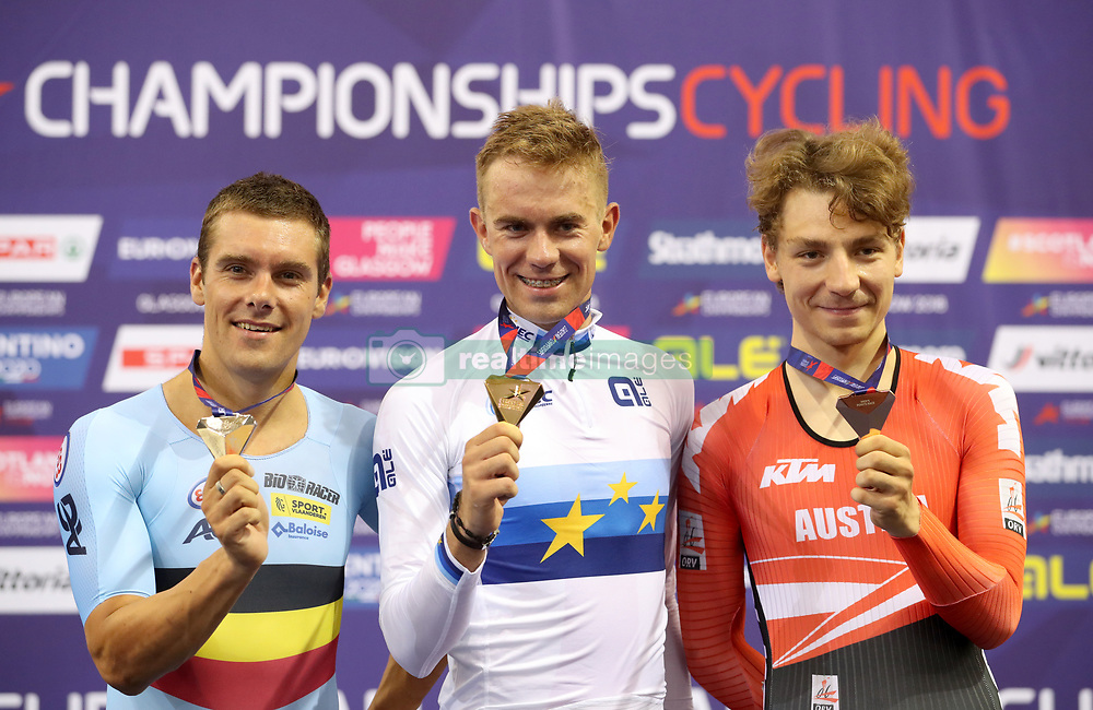 (from left) Silver Medal winner Belgium's Kenny De Ketele, Gold Medal winner Poland's Wojciech Pszczolarski and Bronze Medal winner Austria's Stefan Matzner on the podium for the Mens 40km Points Race during day four of the 2018 European Championships at the Sir Chris Hoy Velodrome, Glasgow. PRESS ASSOCIATION Photo. Picture date: Sunday August 5, 2018. See PA story CYCLING European. Photo credit should read: Jane Barlow/PA Wire. RESTRICTIONS: Editorial use only, no commercial use without prior permission