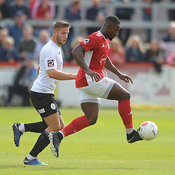 TELFORD COPYRIGHT MIKE SHERIDAN Zak Lilly of Telford closes down Lee Ndlovu during the National League North fixture between Brackley Town and AFC Telford United at St James's Park on Saturday, September 7, 2019<br /> <br /> Picture credit: Mike Sheridan<br /> <br /> MS201920-016