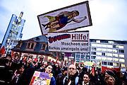 Frankfurt am Main | 09 Feb 2015<br /> <br /> Am Montag (09.02.2015) demonstrierte bereits zum dritten Mal die islamfeindliche und rassistische Gruppierung PEGIDA (Patrioden gegen die Islamisierung des Abendlandes) unter F&uuml;hrung der Frankfurterin Heidi Mund und in Gegenwart des Neonazis und Vorsitzenden der NPD Hessen, Stefan Jagsch, an der Katharinenkirche in Frankfurt am Main, PEGIDA konnte etwa 100 Demonstranten mobilisieren. An den Gegendemos nahmen etwa 1000 Menschen teil.<br /> Hier: Transparent &quot;Superheidi&quot; mit Heidi Mund als Superwoman.<br /> <br /> &copy;peter-juelich.com<br /> <br /> [No Model Release | No Property Release]
